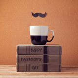 Happy Father's day greeting with cup and books Stock Photography