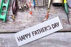 Happy Father`s Day greeting paper. Fishing tackle near card. Relaxing weekend for dad Stock Image