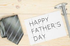 Happy father`s day greetings card. With neck tie and trammel royalty free stock photography