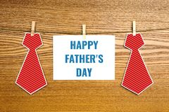 Happy father`s day greetings card. With red paper neckties stock photo
