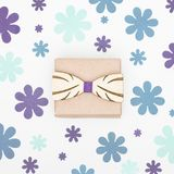 Happy Father`s Day grey blue and purple colored background. Beautiful wooden bow tie and present floral flat lay. Fathers day greeting card Stock Images