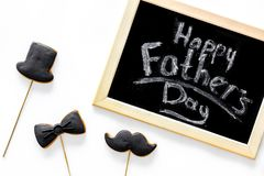 Happy father`s day morning with black tie, mustache and hat cookies for celebrate white background top view Royalty Free Stock Images