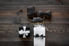 Happy father`s day morning with black tie, mustache and hat cookies, gift box for celebrate wooden background top view Royalty Free Stock Photos