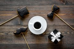 Happy father`s day morning with black tie, mustache and hat cookies, gift box for celebrate wooden background top view Royalty Free Stock Image