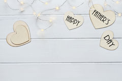 Happy Father`s Day over Hearts with Fairy Lights Royalty Free Stock Images