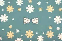 Happy Father`s Day pastel coloured background. Beautiful wooden bow tie floral flat lay. Fathers day. Happy Father`s Day pastel coloured background. Beautiful stock image