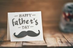 Happy father`s day. ! Postcard on background of wooden table royalty free stock images