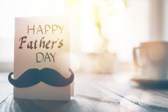 Happy father`s day. ! Postcard on background of wooden table royalty free stock image