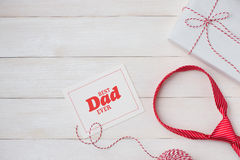 Happy Father`s Day with striped tie on wooden background. Greeti Stock Image
