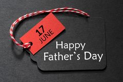 Happy Father`s Day text on a black tag. With red and white twine stock images