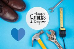 Free Happy Father`s Day Text On Card With Old Rusty Tools And Leather Shoes On Blue Paper Stock Photo - 165301390