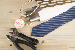 Happy father's day. Tie, flask, tools on wooden background. Royalty Free Stock Image