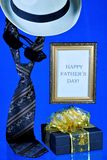 Happy father`s day-tie, hat and gift on creative blue background. An annual celebration in honor of the fathers, a place of honor. For the popes on this special stock photos
