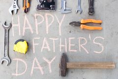 Happy father`s day . Various tools on the cement floor stock images
