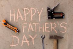Happy father`s day . Various tools on the cement floor.  stock photos