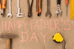 Happy father`s day . Various tools on the cement floor.  stock photography