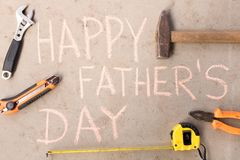 Happy father`s day . Various tools on the cement floor stock image