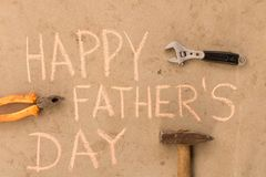 Happy father`s day . Various tools on the cement floor.  stock images