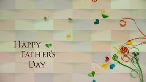Happy Father`s Day words with small colorful heart shaped and gift boxes as background. royalty free stock photo