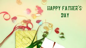 Happy Father`s Day words with small colorful heart shaped and gift boxes as background. royalty free stock photography