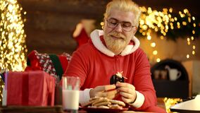 Happy father in santa costume with sparkles, bengal light. Positive human facial expressions and emotions.