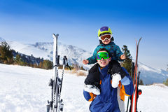 Happy father in ski mask with son on shoulders Stock Images
