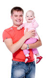 Happy father with smile holding his baby Stock Image