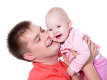 Happy father with smile holding his baby Stock Photos