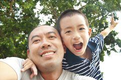 Happy father and son. In the park stock image