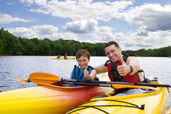 Happy father and son. Father and son enjoying kayaking Royalty Free Stock Photos