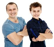 Happy father and son with arms folded Royalty Free Stock Images