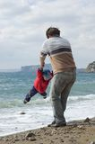 Happy father and son on the beach Royalty Free Stock Photo