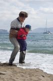 Happy father and son on the beach Stock Photography