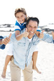 Happy father and son on the beach with thumbs up Royalty Free Stock Photos