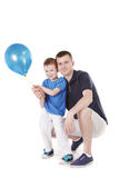 Happy father and son with blue balloon Royalty Free Stock Photo