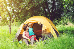 Happy father and son at camping in summer. Toned. Stock Photos