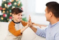 Happy father and son doing high five at christmas Stock Images