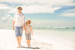 Happy father and son enjoying beach time on summer Royalty Free Stock Images