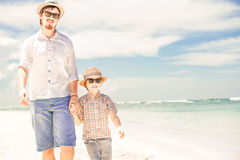Happy father and son enjoying beach time on summer Stock Images