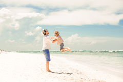 Happy father and son enjoying beach time on summer Royalty Free Stock Photography