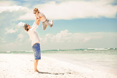 Happy father and son enjoying beach time on summer Royalty Free Stock Photo