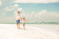 Happy father and son enjoying beach time on summer Stock Photo