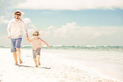 Happy father and son enjoying beach time on summer Stock Image