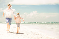 Happy father and son enjoying beach time on summer Stock Photography