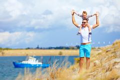 Happy father and son enjoying seaside landscape Royalty Free Stock Photography