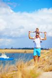 Happy father and son enjoying seaside landscape Stock Photos