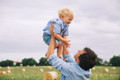 Happy father and son. Family outdoors together stock images