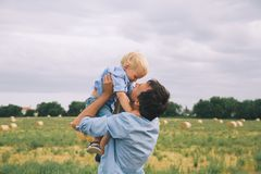 Happy father and son. Family outdoors together royalty free stock photo
