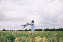 Happy father and son. Family outdoors together stock image