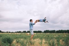 Happy father and son. Family outdoors together stock photo